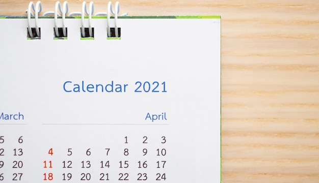 Calendar page 2021 close up on wood table background business planning