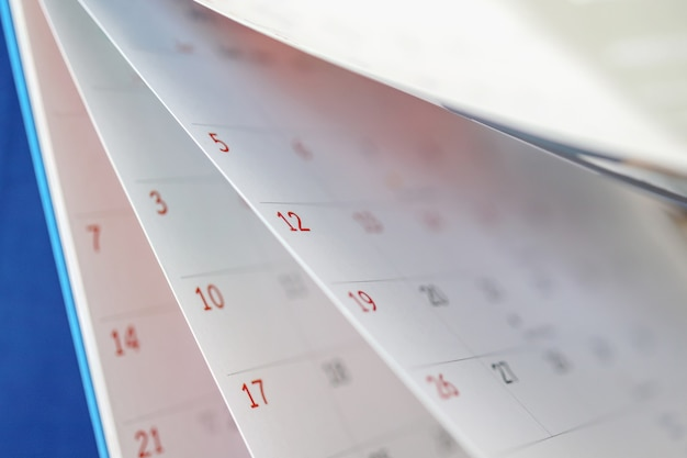 カレンダーページめくりシートクローズアップオフィステーブルインテリア背景ビジネススケジュール計画予定会議コンセプト