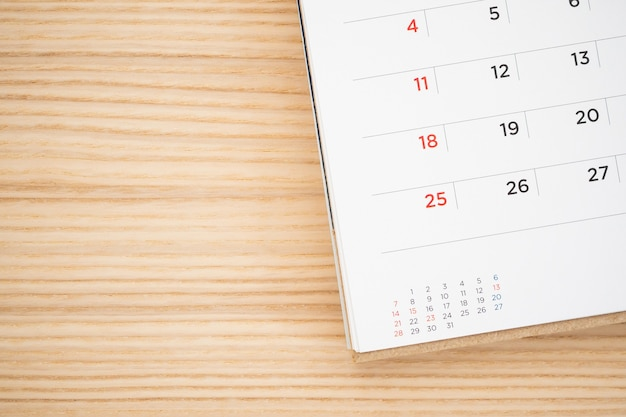 Calendar page on wood table background