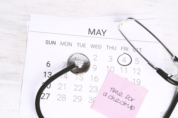 Calendar and stethoscope.