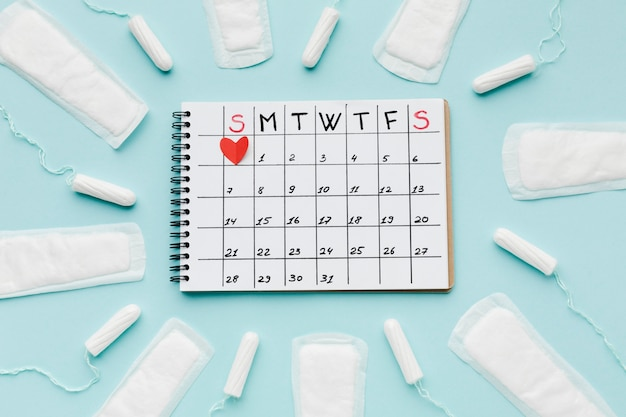 Calendar surrounded by feminine products