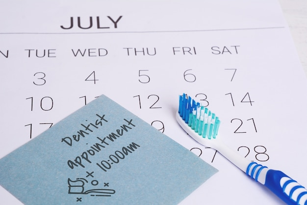 Calendar and toothbrush.