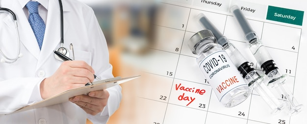 Calendar with a date of vaccination with a doctor filling out the medical chart.