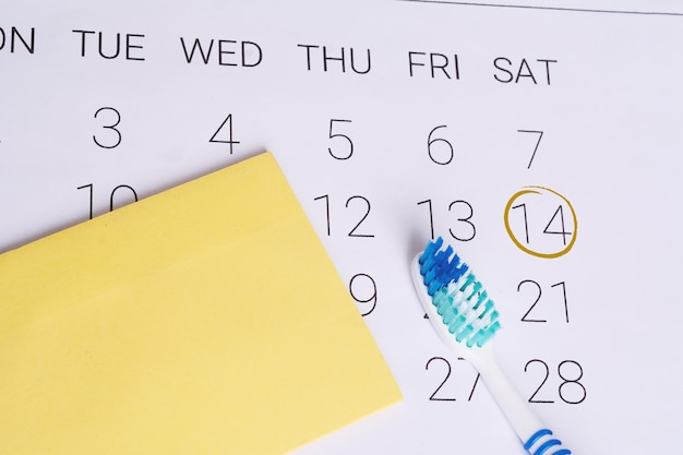 Calendar with a marked date and toothbrush.