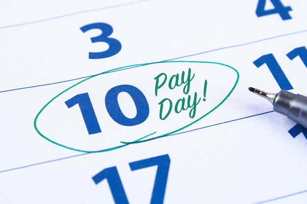 Calendar with marker circle in word payday