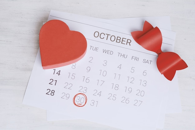 Calendar with red gift box.