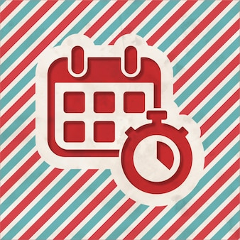 Calendar with stopwatch on red and blue striped background. vintage concept in flat design.