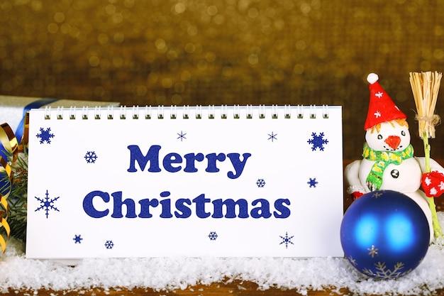 Календарь с текстом с рождеством и украшением