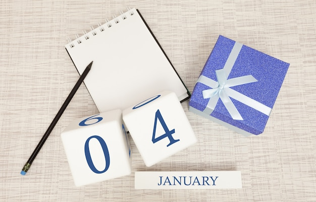Calendar with trendy blue text and numbers for january 4th and a gift in a box