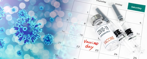 Календарь с датами вакцинации, вакциной covid-19 и медицинской концепцией