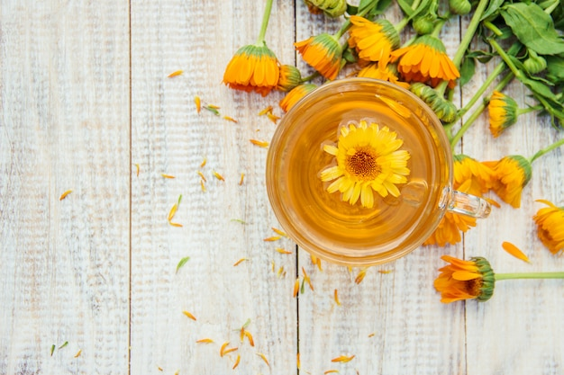 Calendula tea and flowers. selective focus. nature.