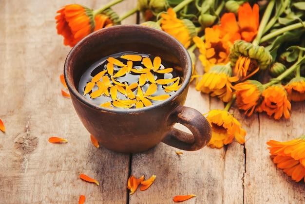 Calendula tea and flowers. selective focus. nature.
