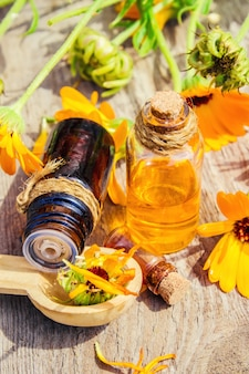 Calendula tincture in a small bottle. selective focus.