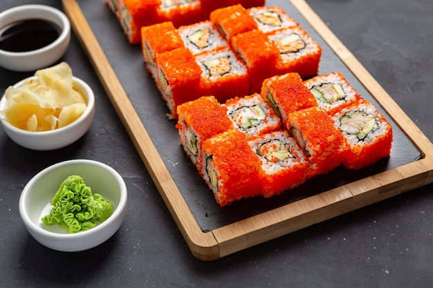 California maki sushi with masago - roll made of crab meat, avocado, cucumber inside.