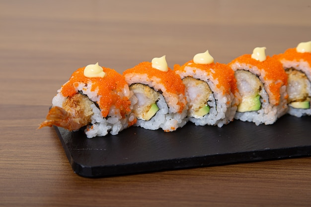 California roll with salmon, avocado, cucumber, crab and flying fish egg.