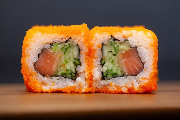 California rolls with salmon and cucumber on dark