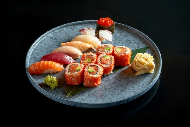 Californian sushi roll set with salmon in tobiko caviar and various sushi. sushi with salmon, tuna, shrimp.