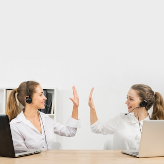 Call center agents doing high five