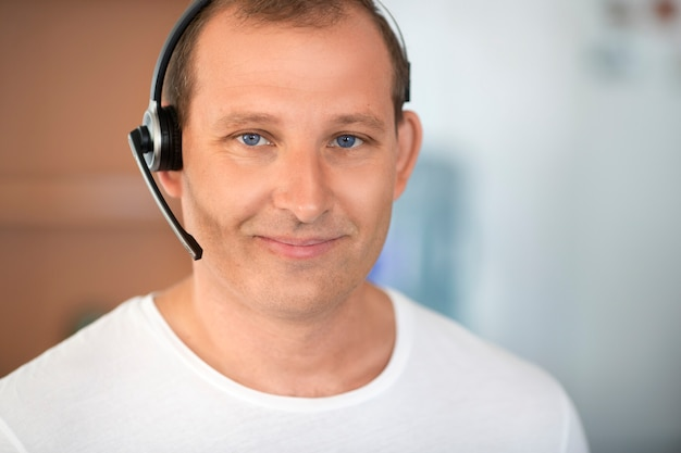 Call center concept. smiling middle aged man with headset. close up portrait.