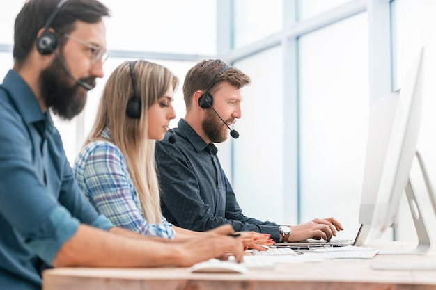 Call center operators work in a modern office