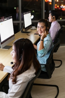 Call center smiling with night