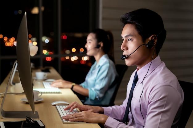 Call center working hard at night.