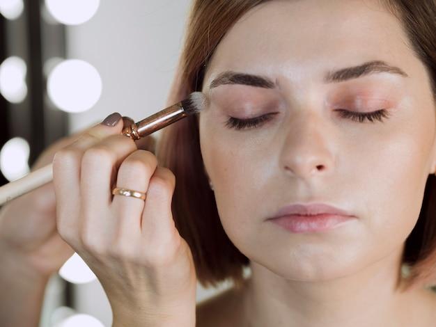 Calm beautiful makeup model close up