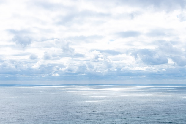 Calm blue sea and clouds in the sky