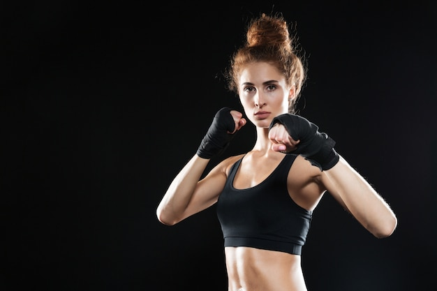 Calm female fighter ready to fight