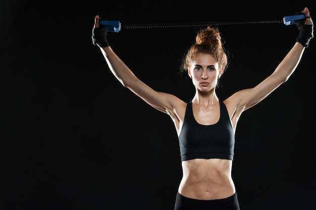 Calm female fighter using expander