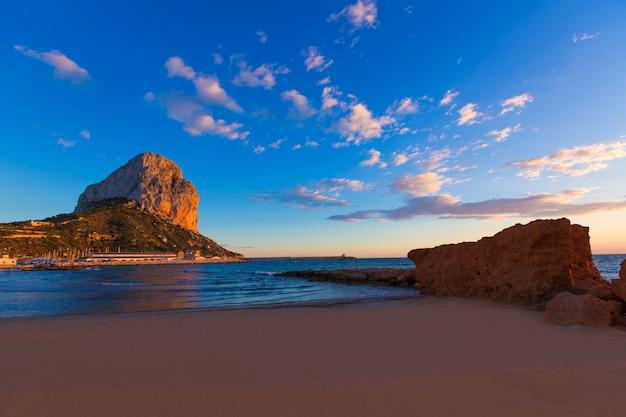 Calpe alicante sunset at beach cantal roig in spain