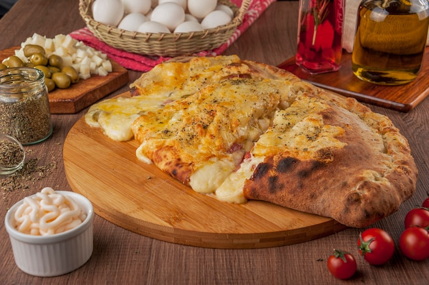 Calzone pizza with ham, cream cheese and heart of palm