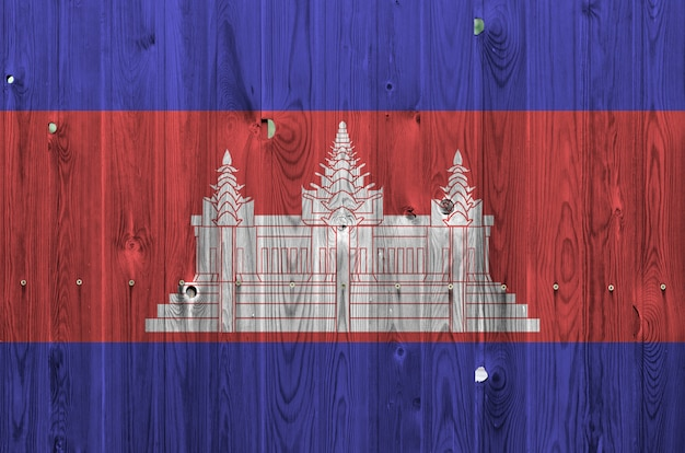 Cambodia flag depicted in bright paint colors on old wooden wall.
