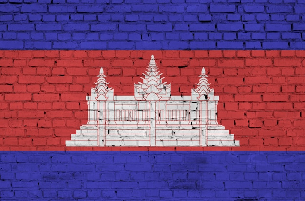 Cambodia flag is painted onto an old brick wall