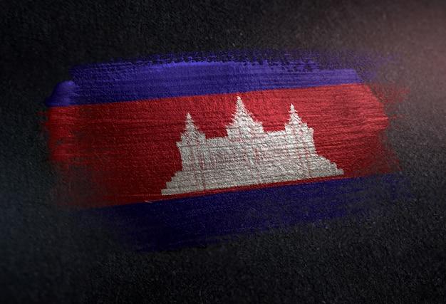 Cambodia flag made of metallic brush paint on grunge dark wall