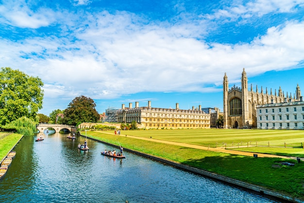 Cambridge, cambridgeshire, united kingdom - aug 28, 2019: tourists on punt trip along river cam near kings college in the city of cambridge, united kingdom