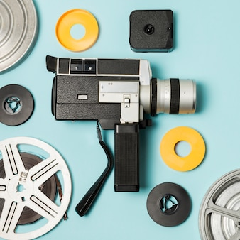 Camcorder and film reels cases on blue background