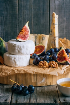 Camembert and blue cheese stilton with figs honey and grapes.