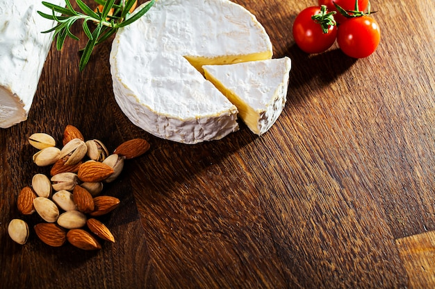 Camembert cheese or brie on wooden background