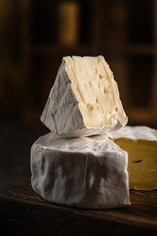 Camembert cheese is lying on the table, close-up, side view. high quality photo
