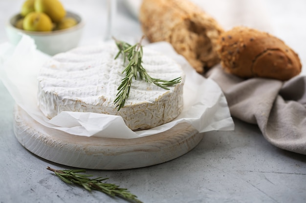 Camembert cheese with rosemary and olives
