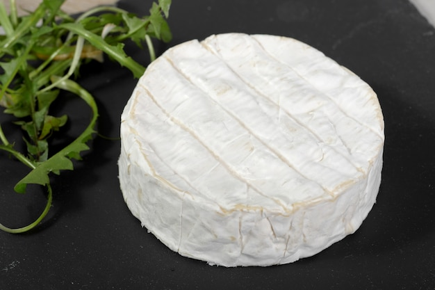 Camembert of normandy on a slate