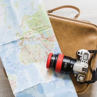 Camera and map on the travelling bag