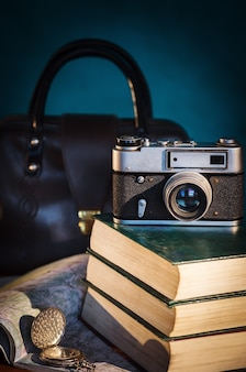 Camera, books, clock and road map