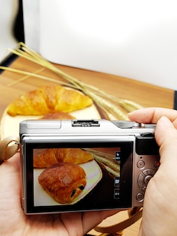 Camera capture yummy pastry : chocolate croissant