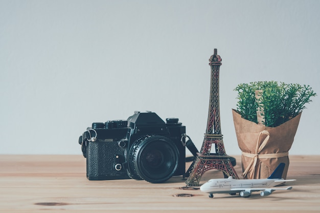 Camera, eiffel tower simulator, plane simulator, put on wooden floor travel planning concepts