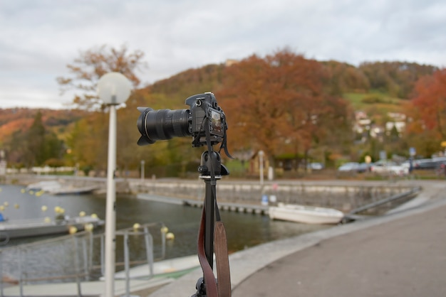 Camera is taking landscape photo at autumn