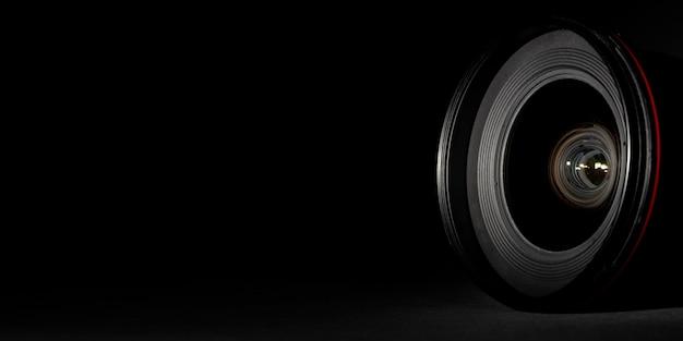 Camera lens on black surface