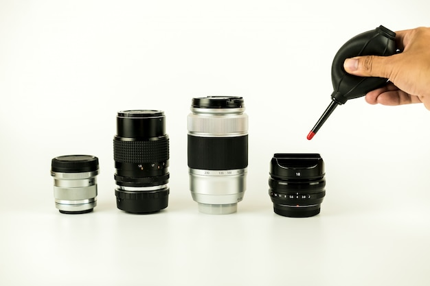 Camera lens cleaning method close focus by human photo on the white background