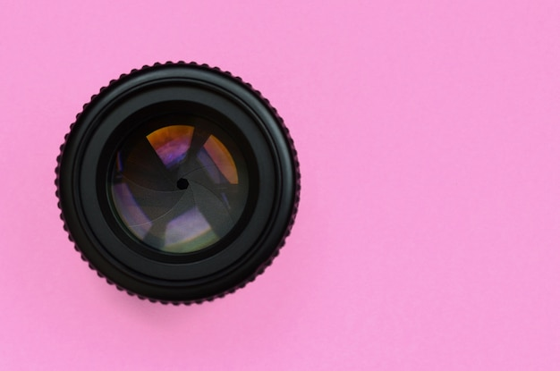 Camera lens with a closed aperture lie on texture background Premium Photo